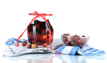 Yummy jam in bank on napkin isolated on white Stock Photo - 20996633