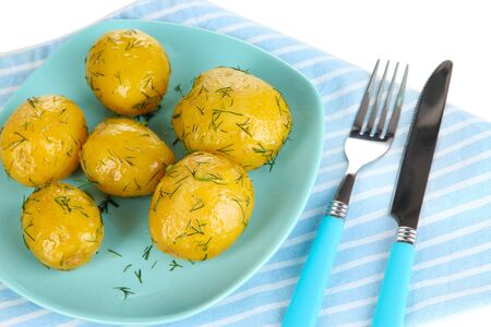 platen: Boiled potatoes on platen on napkin isolated on white