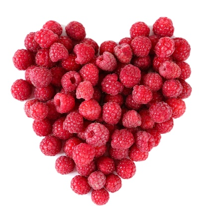 Ripe sweet raspberries isolated on white photo