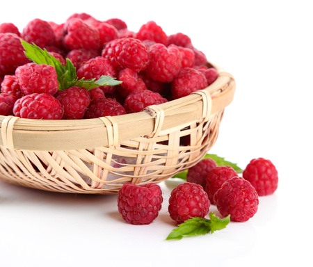 Ripe sweet raspberries in basket, isolated on white photo