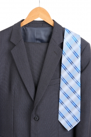 Suit and tie on hanger on white background photo