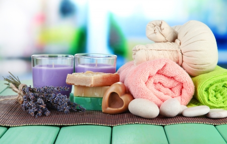 Still life with lavender candle, soap, massage balls, soap and fresh lavender, on bright background photo