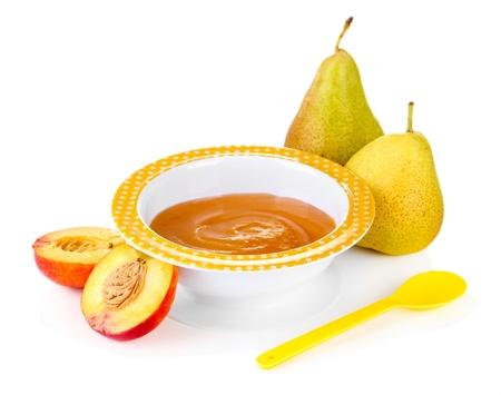 Tasty baby fruit puree isolated on white photo