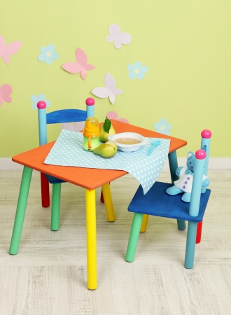 Tasty baby fruit puree and baby bottle on table in room Stock Photo - 20998193