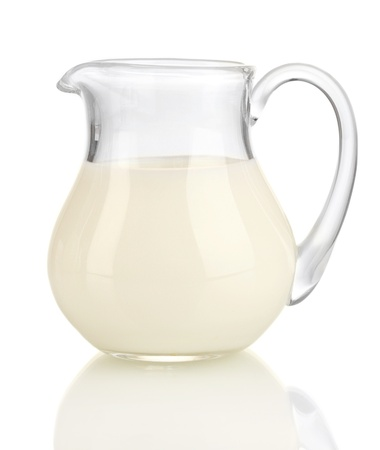creamer: Milk in jug isolated on white