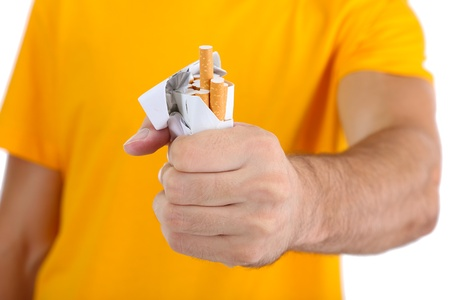 Man with crushed pack of cigarettes, close up photo
