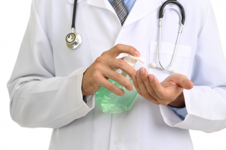 sanitizer: Medical doctor using sanitizer dispenser