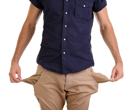 Man showing his empty pockets, isolated on white photo