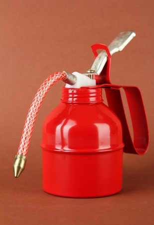 Red oil can, on color background Stock Photo - 21033195