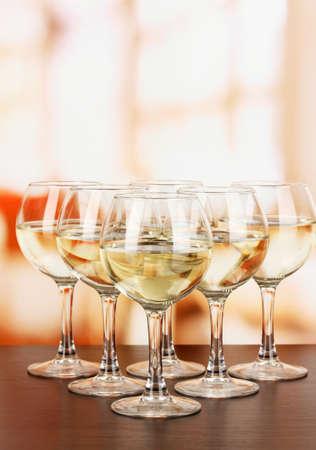 degustation: White wine in glass on room background
