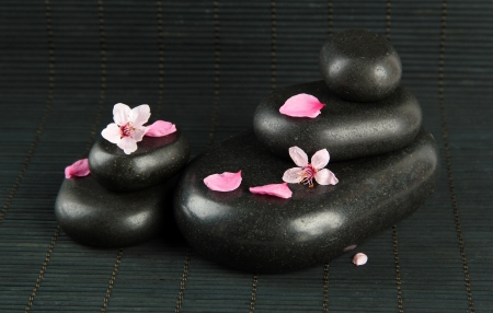 Spa stones and flowers on bamboo background photo