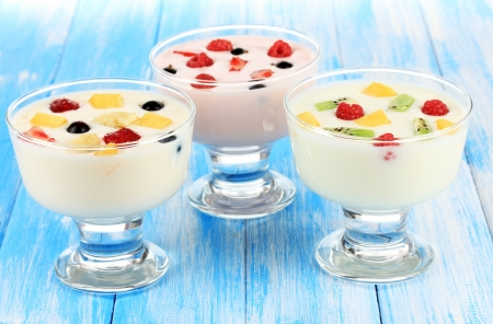 Delicious yogurt with fruit on table close-up photo