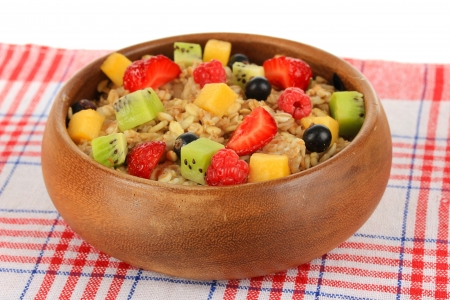 Oatmeal with fruits close-up photo