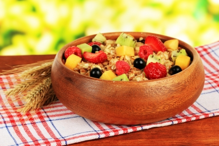 meatless: Oatmeal with fruits on table on bright background