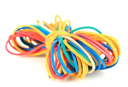 Colorful rubber bands isolated on white photo