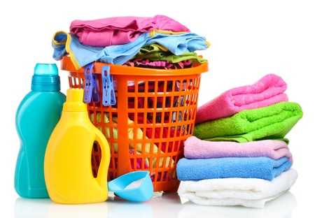 dirty clothes: Clothes with detergent and washing powder in orange plastic basket isolated on white Stock Photo