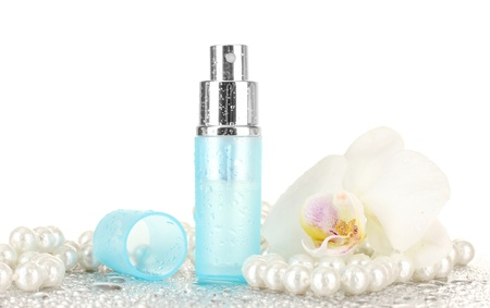 womens perfume in beautiful bottle and orchid flower, isolated on white photo
