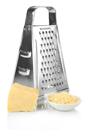 Metal grater and cheese, isolated on white photo