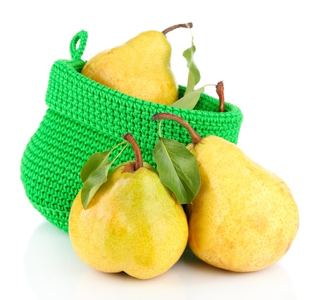 Juicy pears in basket isolated on white photo