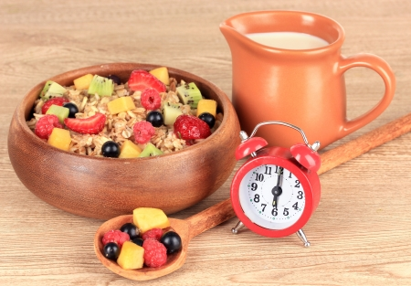 Oatmeal with fruits on table close-up photo