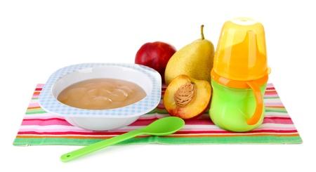 Tasty baby fruit puree and baby bottle isolated on white photo