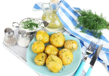 platen: Boiled potatoes on platen on wooden board on napkin isolated on white