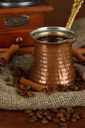 Metal turk and coffee beans on dark background photo