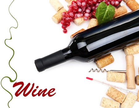 Bottle of wine, grapes and corks, isolated on white photo