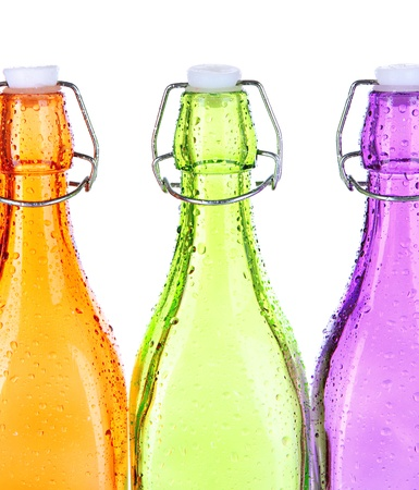 Colorful bottles isolated on white photo