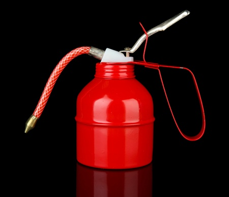 lubricate: Red oil can, isolated on black Stock Photo