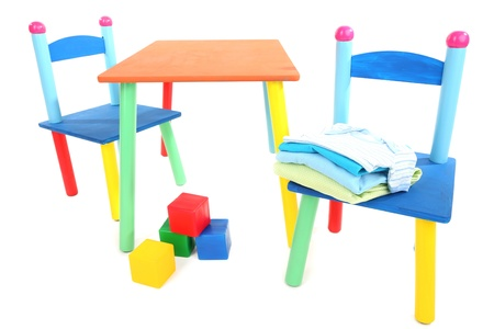 Small and colorful table and chairs for little kids isolated on white photo