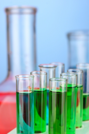 Test-tubes on color background photo