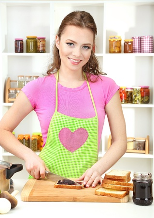 culinary skills: Young woman cooking in kitchen