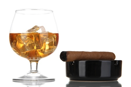 drunks: Brandy glass with ice and cigar isolated on white Stock Photo