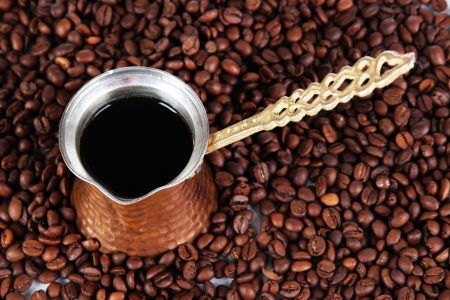 Coffee pot on coffee beans background photo