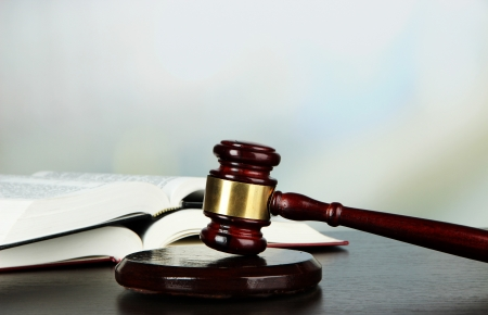 legal court: Gavel and books on table on light background Stock Photo