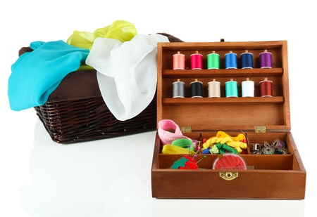 Sewing kit in wooden box and basket with cloth isolated on white photo