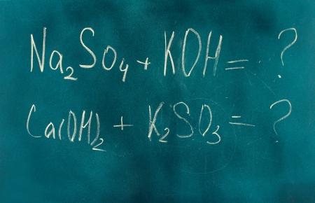 Chemical formula written on blackboard with chalk. photo