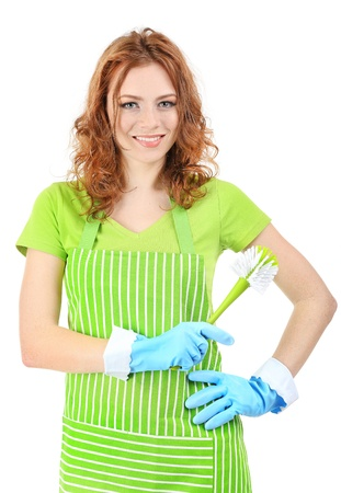 Young woman wearing green apron and rubber gloves with brush, isolated on white photo