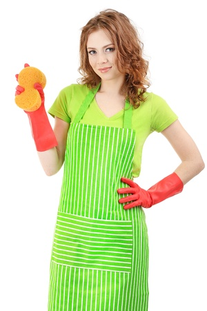 Young woman wearing green apron and rubber gloves with sponge, isolated on white photo