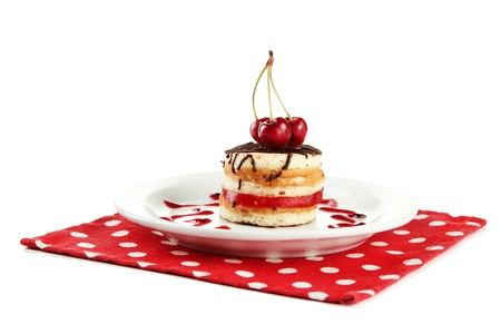 Tasty biscuit cake on plate isolated on white photo