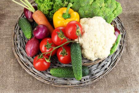 Fresh vegetables on burlap background photo