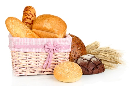 Baked bread in wicker basket isolated on white photo