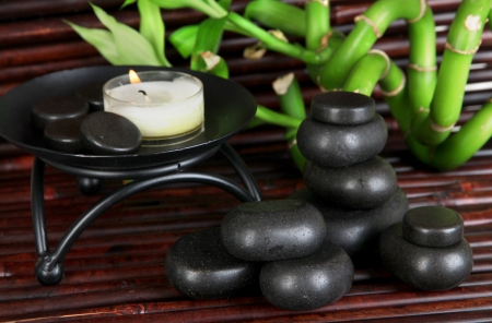 Spa stones and bamboo on bamboo mat background Stock Photo - 21232452