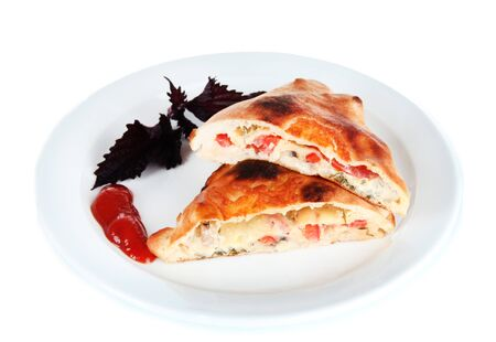 Pizza calzone on plate isolated on white photo