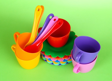 Set of childrens dishes on light green background photo