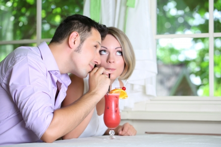 Beautiful couple  drinking together cocktail at restaurant photo