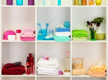 shelfs: Bath accessories on shelfs in bathroom Stock Photo