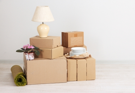 moving up: Moving boxes on the floor in empty room