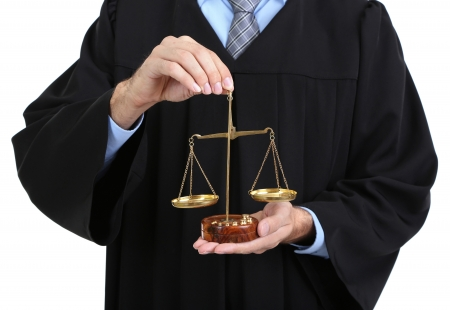 golden rule: Judge holding scales isolated on white
